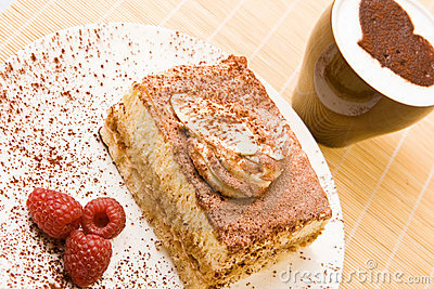 Delicious tiramisu with raspberries and cappuccino