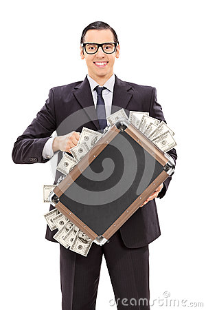Free Delighted Businessman Holding A Briefcase Full Of Money Royalty Free Stock Images - 46233599