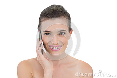 Delighted natural brown haired model making a phone call