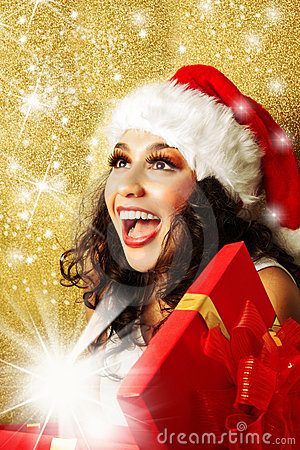 Delighted woman with gift in Santa Claus hat
