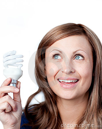 Delighted woman holding a light bulb