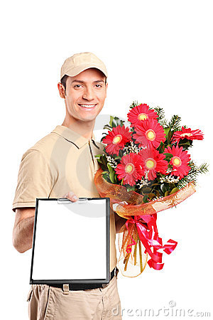 Delivery boy delivering bouquet of flowers