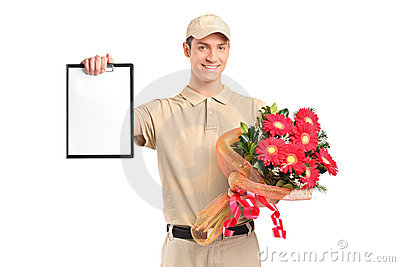 Delivery boy holding a bouquet of flowers