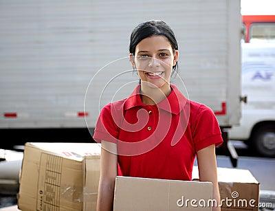 Delivery courier or mover delivering cardboards