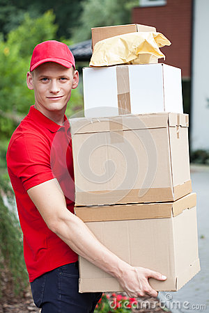 Delivery man holding cardboard boxes