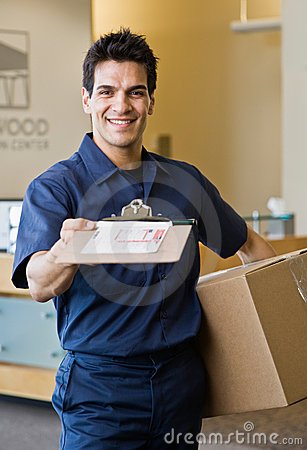 Free Delivery Man Presenting Shipping Receipt Royalty Free Stock Image - 6604826
