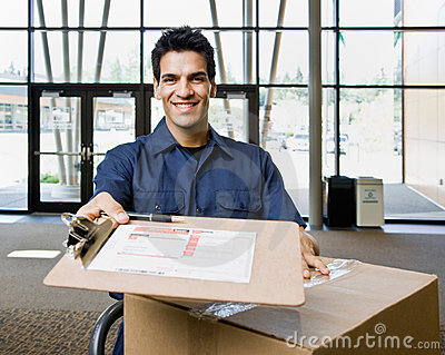 Delivery man in uniform with stack of boxes