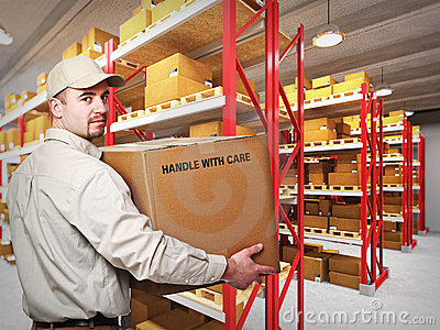 Delivery man in warehouse