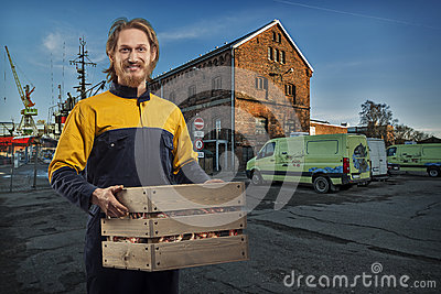 Delivery or mover man with box in the port
