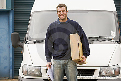 Delivery person standing with parcel