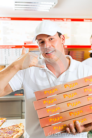 Free Delivery Service - Man Holding Pizza Boxes Stock Photography - 28159262