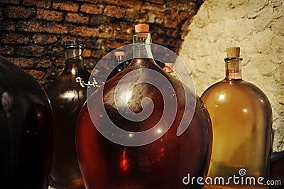 Demijohns in wine cellar
