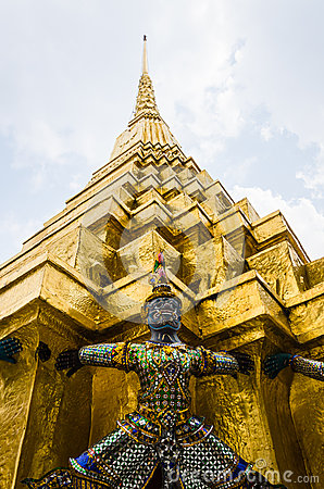 The demon statue supporting golden pagoda