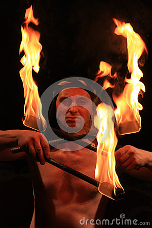 Free Demonic Looking Man With The Fire Torches  Royalty Free Stock Images - 82689659