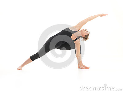 Demonstration of advanced yoga pose by young attractive woman