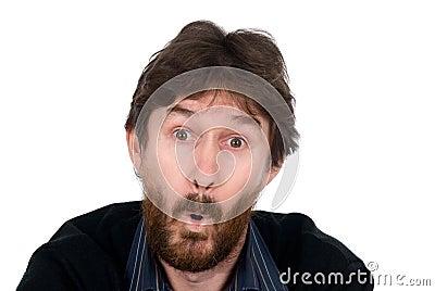 Den förvånada mannen med ett skägg