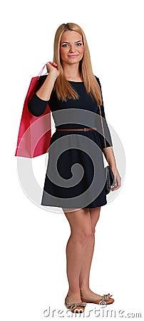 Den unga kvinnan med shopping hänger lös