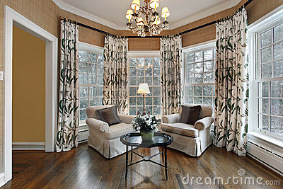 Den with wall of windows