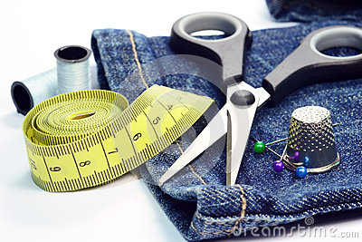 Denim jeans and sewing utensils