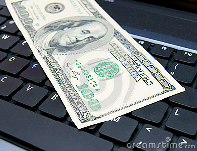 Denomination (dollar) on the laptop.
