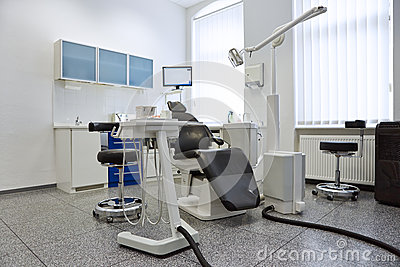 Dental chair in bright treatment room
