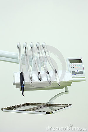 Dental drills and tools and control panel.