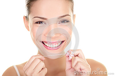 Dental floss - woman flossing teeth smiling