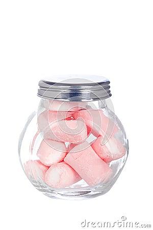 Dentelli le caramelle gommosa e molle nel vaso di vetro
