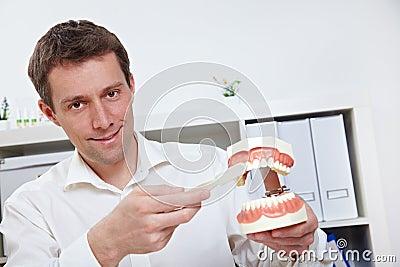 Dentist brushing teeth