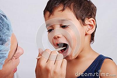 A dentist and cute kid