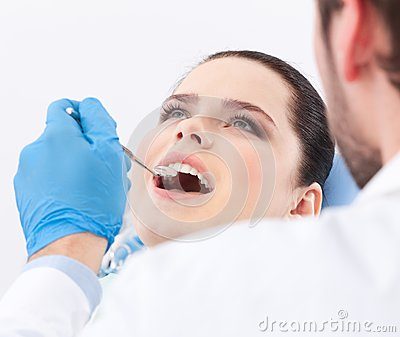 Dentist examines teeth of the patient