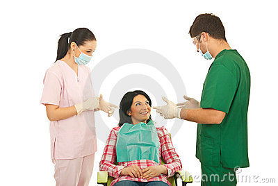 Dentist having conversation with patient