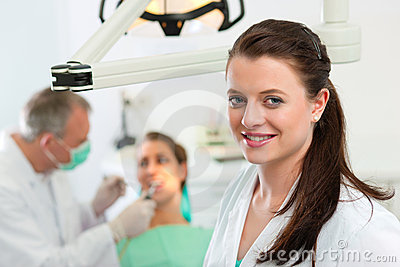 Dentist in her surgery