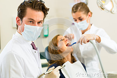 Dentist in his surgery