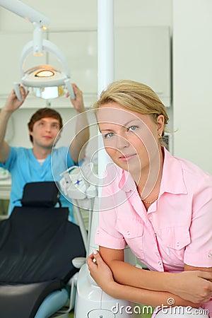 Dentist looks at camera in dental clinic