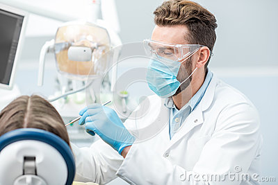 Dentist during the surgery Stock Photo