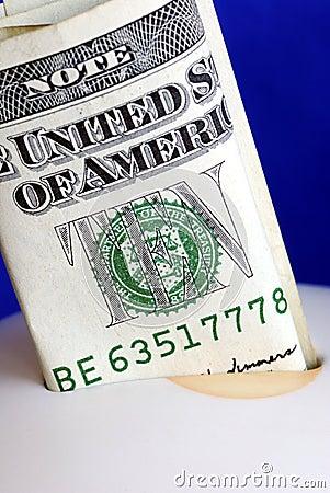 Deposit ten dollars into the piggy bank