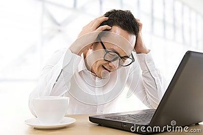 Depressed Asian business man