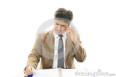 Depressed Asian businessmen