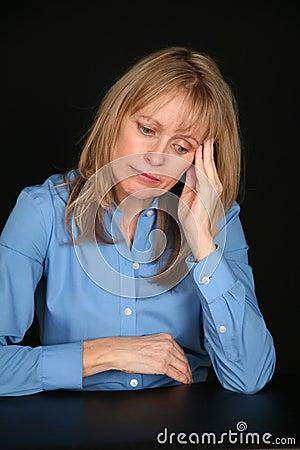 Depressed blonde older woman