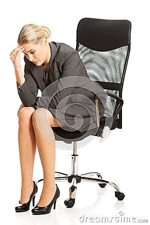 Free Depressed Businesswoman Sitting On Armchair Royalty Free Stock Photos - 123179838