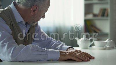 Depressed Elderly Man Sitting At Kitchen Table, Widower ...