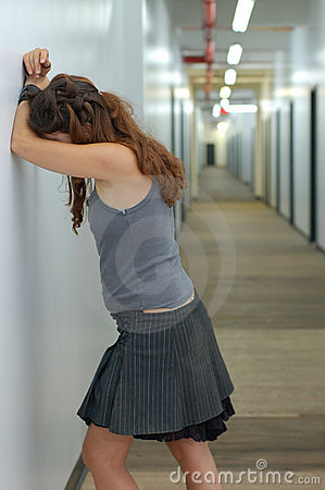 Depressed girl in a long corridor 2