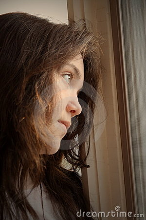 Free Depressed Looking Out Window Stock Photography - 8675722