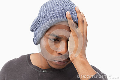 Depressed man in beanie hat