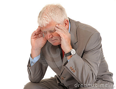 Depressed mature businessman holding head