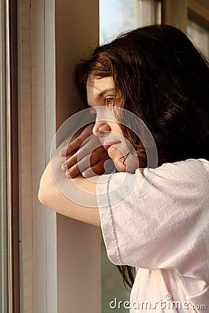 Depressed sad  looking out window
