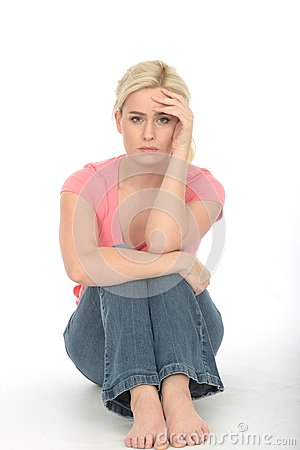 Free Depressed Sad Unhappy Young Woman Sitting Alone On The Floor Looking Bored Royalty Free Stock Photo - 53704035