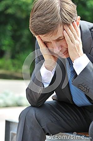 Depressed senior business man portrait