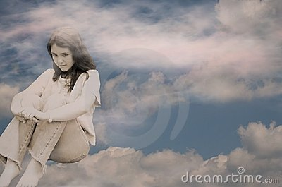 Depressed teen girl in clouds